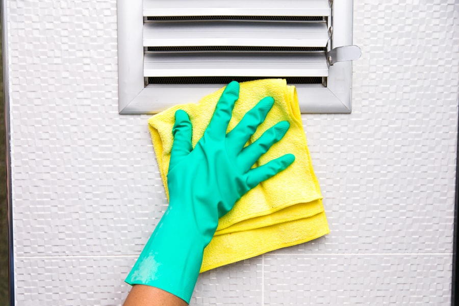 person performing air duct cleaning