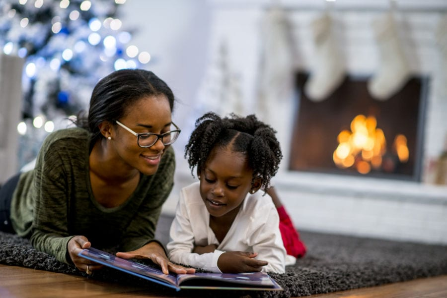Mother and daughter relaxing and learning about the ways they can save money on their heating bill this winter.
