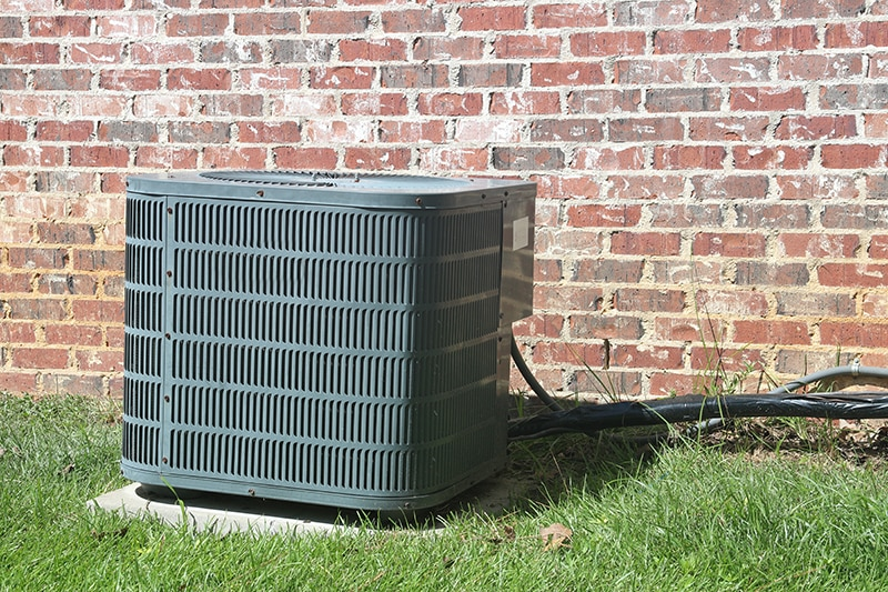 air conditioner in back yard of home representing the top causes of AC failure.
