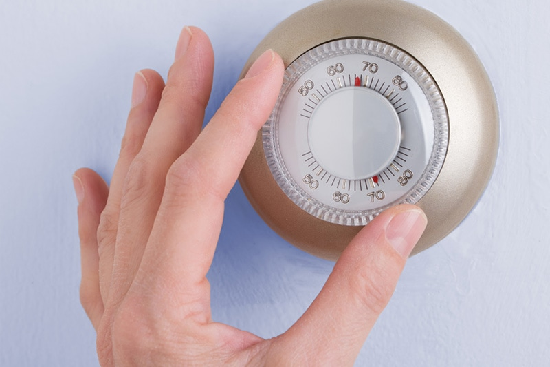 hand adjusting thermostat, What Is Short Cycling?